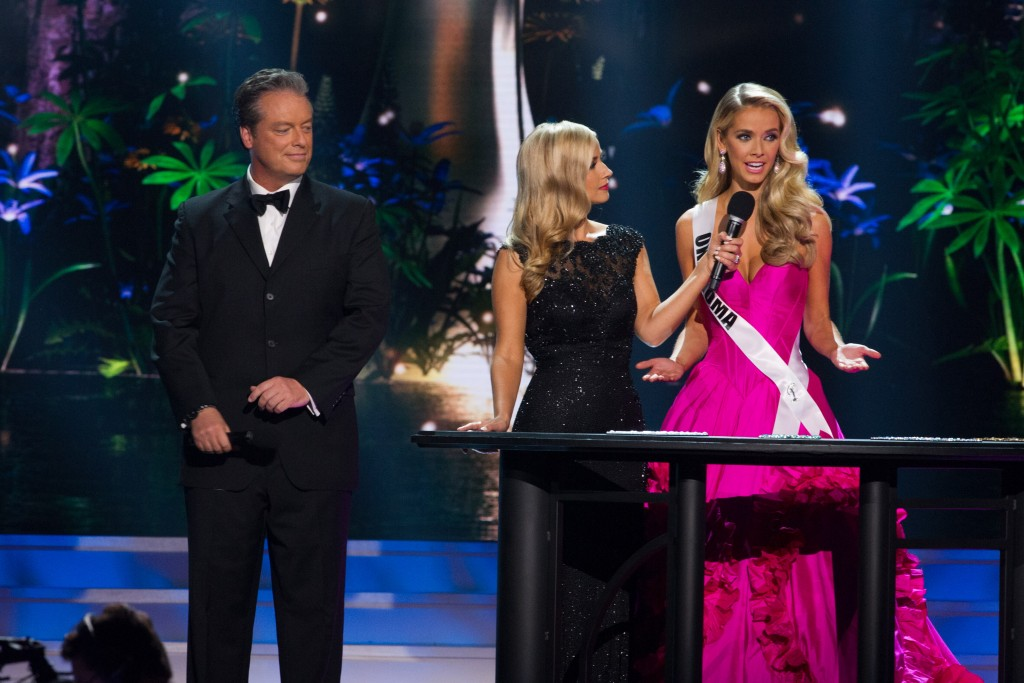 Hosts Todd Newton and Alex Wehrley  and Olivia Jordan, Miss Oklahoma USA 2015, onstage during the Judges Question portion of the 2015 MISS USA pageant at the Baton Rouge River Center on Sunday, July 12th. The 2015 Miss USA contestants are competing for the D.I.C. Crown in Baton Rouge, Louisiana during the live Reelz telecast at 8:00 PM ET on July 12, 2015. HO/Miss Universe Organization L.P., LLLP