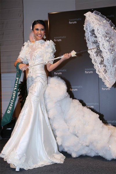 Angelia Ong in her National Costume - a white terno with a parasol as the accessory